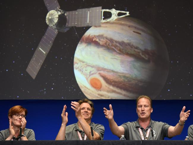 Scientists and engineers celebrate at a press conference after the Juno spacecraft was successfully placed into Jupiter's orbit. Picture: Robyn Beck