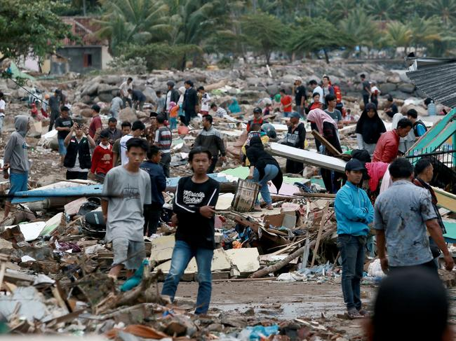 Rescuers and residents look for survivors along the coast in South Lampung on South Sumatra. Picture: AFP