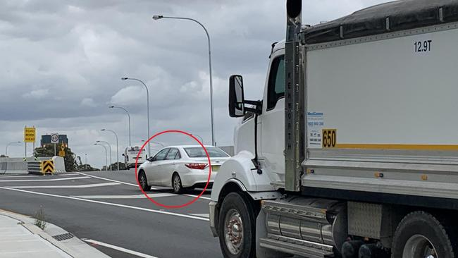 A car dangerously swerving through chevrons on Wattle St, Haberfield, in the way of a truck close to the M4 WestConnex motorway. Picture: Benedict Brook