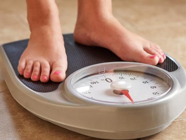 Her partner would ask her to stand on the scales.