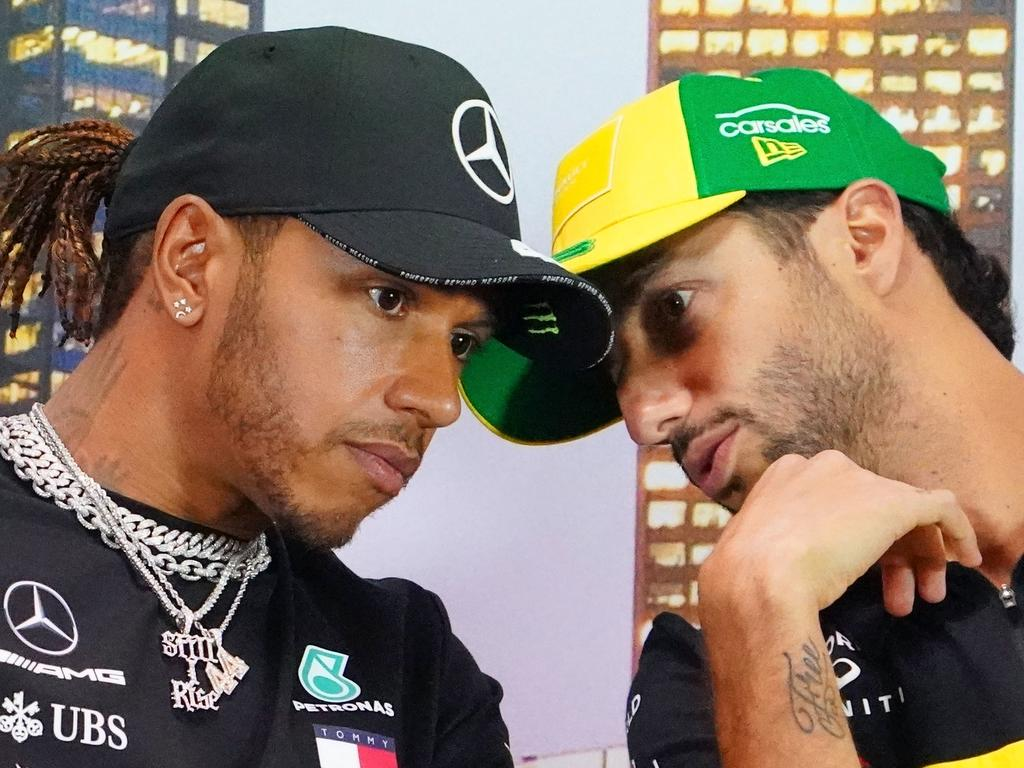 Daniel Ricciardo of Australia and Renault Sport F1 speaks with Lewis Hamilton of Great Britain and Mercedes GP during a press conference ahead of the Formula 1 Australian Grand Prix 2020 at the the Albert Park Circuit in Melbourne, Thursday, March 12, 2020. (AAP Image/Scott Barbour) NO ARCHIVING, EDITORIAL USE ONLY