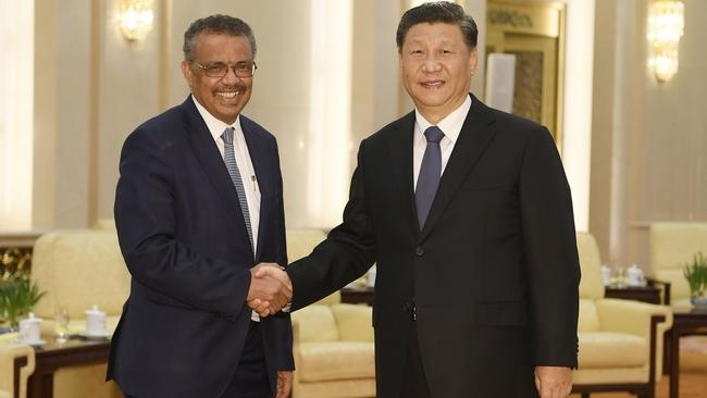 World Health Organisation director general Tedros Adhanom shakes hands with Chinese President Xi Jinping in January. Picture: AFP
