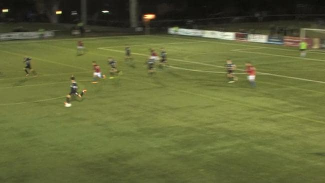 Danny Choi shoots from inside his own half to score.