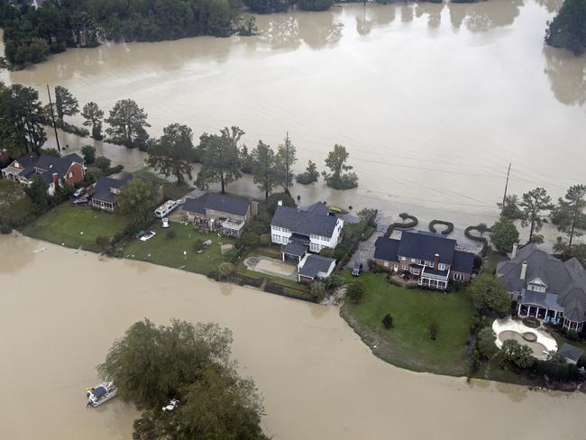 Floodwaters close in on homes on a small piece of land on Lake Katherine in Columbia, South Carolina, on Monday. Picture: AP Photo/Chuck Burton