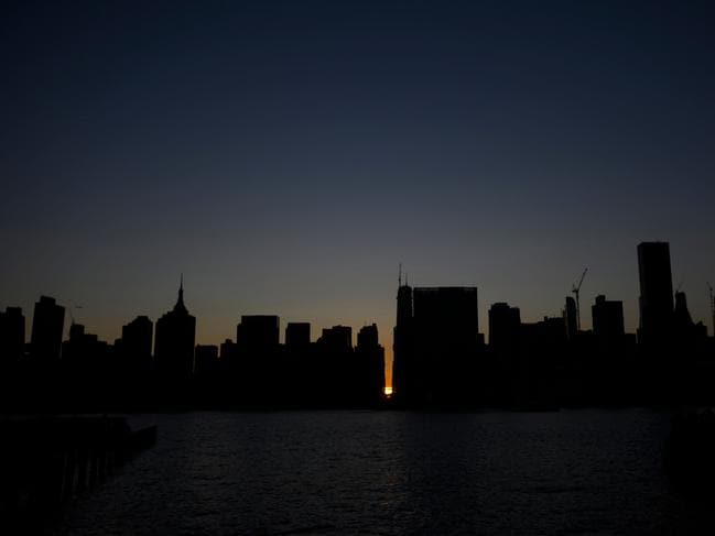 The sun sets behind 42nd Street in Manhattan during a power outage in New York City on July 13, 2019. Picture: AFP