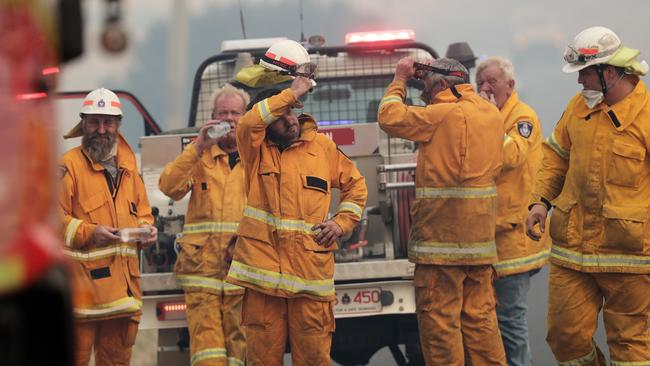 Members of Kempton fire brigade including Jack Jenkins (centre with hand on head) at the Pelham bushfire. Picture: LUKE BOWDEN