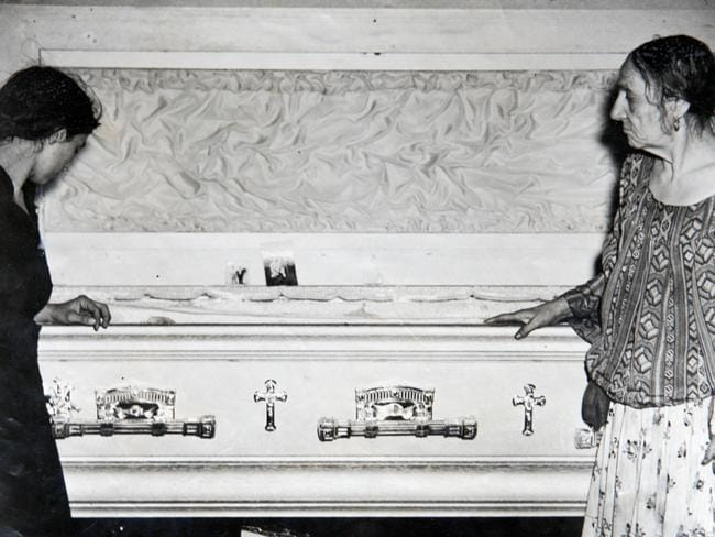 Gypsy Queen Mary Sterio, right, and her daughter-in-law Elizabeth Sterio, left, are pictured with the coffin of Gypsy Prince Costa Sterio in 1943.