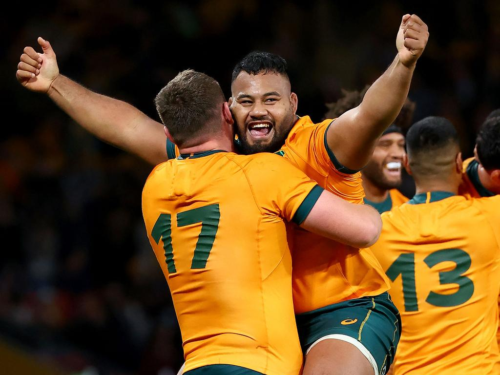 Australia's Taniela Tupou (C) celebrates victory with a teammate Angus Bell (L) against France in the third and final rugby union Test match in Brisbane on July 17, 2021. (Photo by Patrick HAMILTON / AFP) / -- IMAGE RESTRICTED TO EDITORIAL USE - STRICTLY NO COMMERCIAL USE --