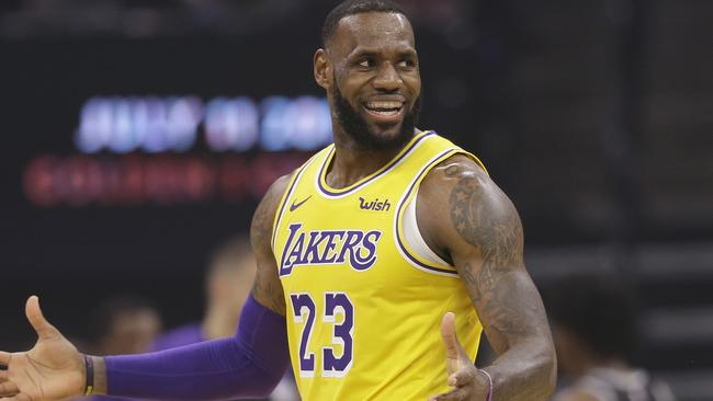 aaa5937bda14 Los Angeles Lakers forward LeBron James gestures during the second half of  an NBA basketball game against the Sacramento Kings