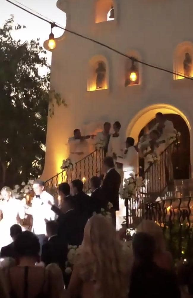 The couple pictured leaving the chapel after the ceremony, followed by a mariachi band. Picture: Instagram