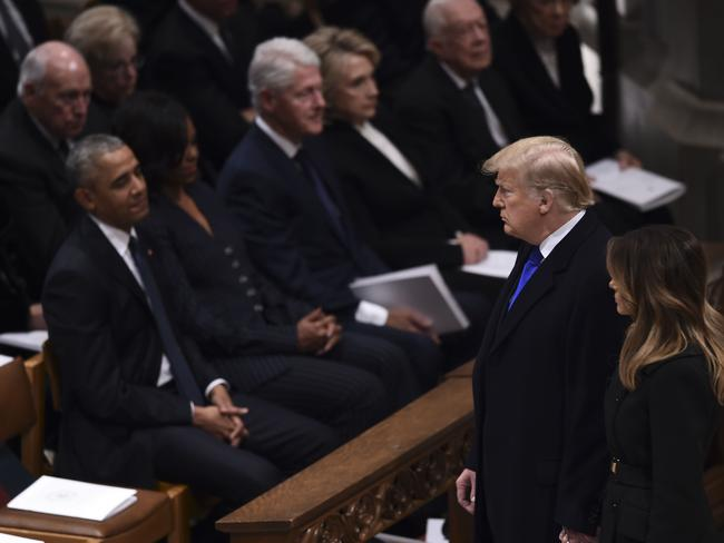 The conversation died as the President and First Lady approached and the group stared quietly ahead. Picture: Brendan Smialowski / AFP