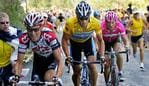 22/07/2005 WIRE: Overall leader and six-time Tour de France winner Lance Armstrong, of Austin, Texas, center, second-placed Ivan Basso of Italy, left, and fourth-placed Jan Ullrich of Germany, pedal in the ascent of the Croix-Neuve pass less than 2 kilometers before the finish of the 18th stage of the Tour de France cycling race between Albi, southwestern France, and Mende, southern France, Thursday, July 21, 2005. (AP Photo/Peter Dejong)