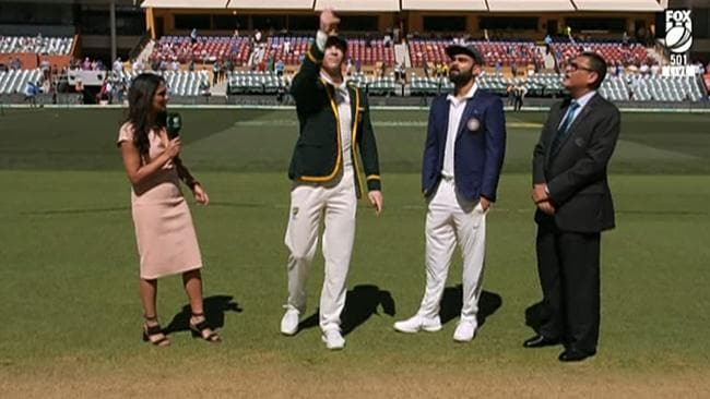 Isa Guha at the coin toss with Australia's Tim Paine and India's Virat Kohli. Pic: Fox Cricket