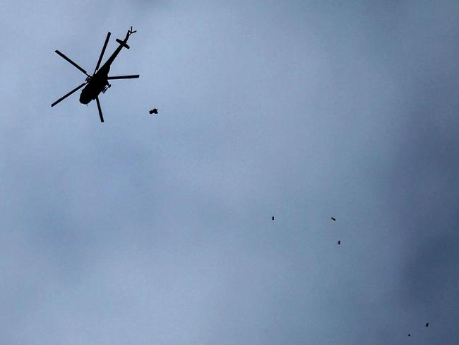 A Russian-made Syrian army attack helicopter dropping a payload over the rebel-held town of Arbin, in the besieged Eastern Ghouta region on the outskirts of the capital Damascus. Picture: AFP
