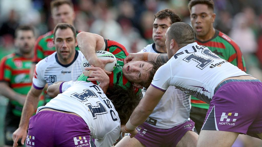 Cam Murray is gang tackle around the head by Storm players. Picture: Shane Myers/NRL Photos