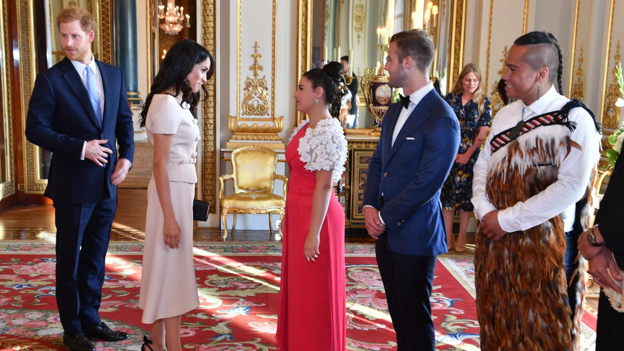 Meghan, Duchess of Sussex and Prince Harry, Duke of Sussex meet guests at the Queen's Young Leaders Awards Ceremony at Buckingham Palace. Picture: Getty