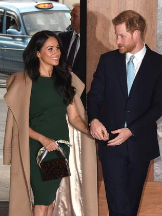 Meghan wore a slim, green dress with a camel-coloured coat. Picture: Stuart C Wilson/Getty Images