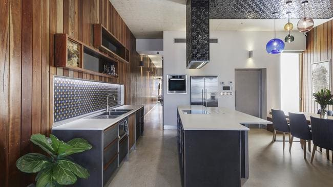 Timber panelling, polished concrete floors and a colourful tile splashback added flair.
