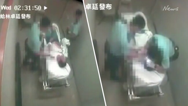 Hong Kong police assault man in hospital trolley