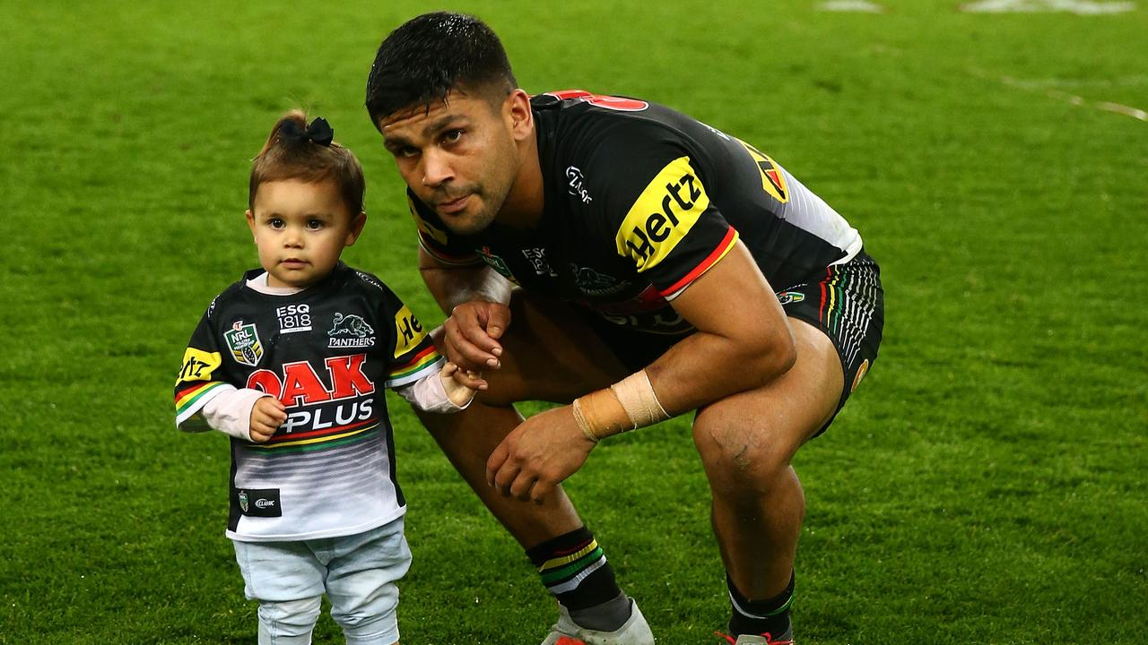 Tyrone Peachey of the Panthers with his daughter after his team's finals win over the Warriors.