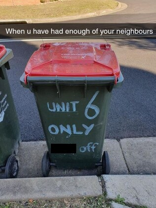 Photos of the bin, covered in aggressive graffiti and zip ties, was shared to social media. Picture: Auburn 2144