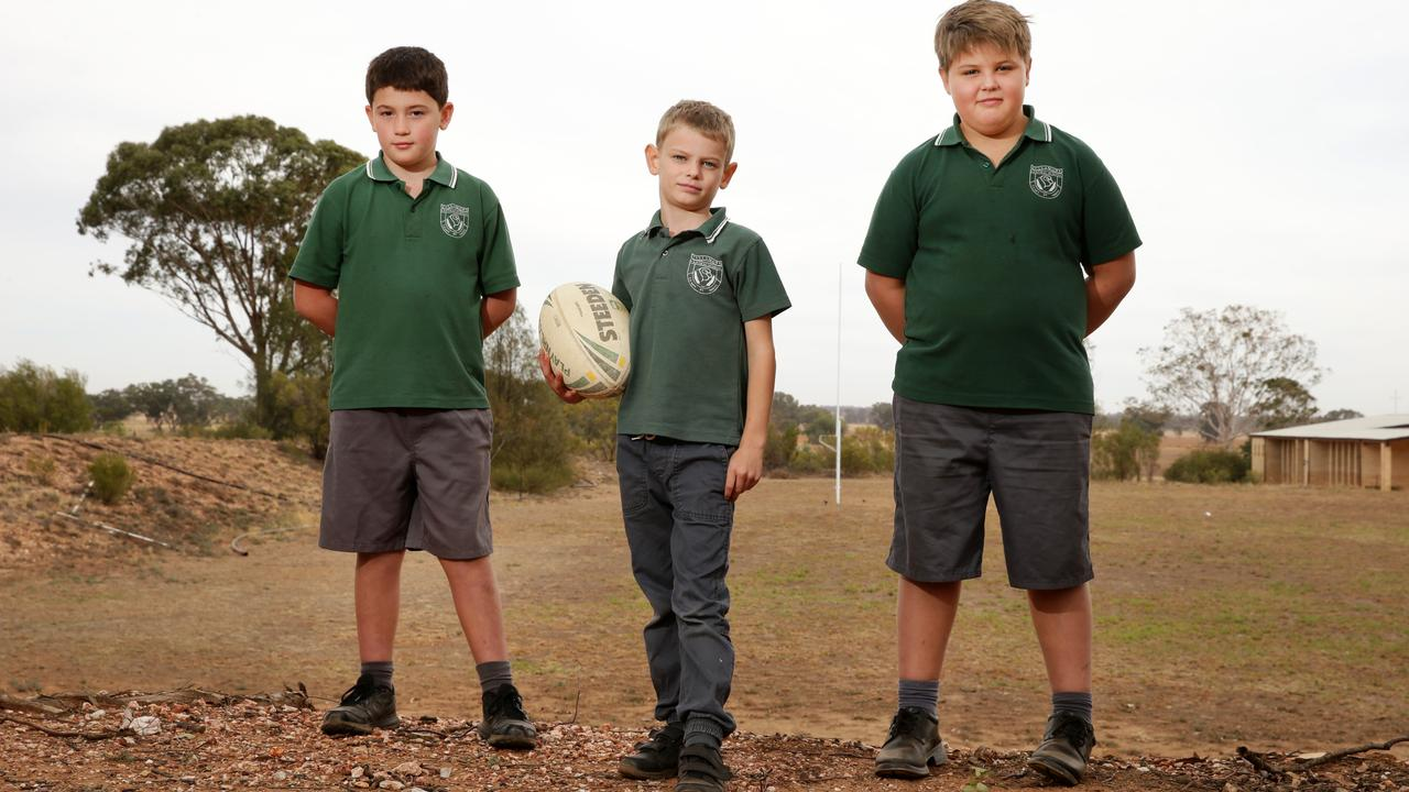 Tullamore students Joe Mortimer, 8, Tristan Laing, 8, and Archie Aveyard, 9, at the school oval that won't be watered after this week. Picture: Jonathan Ng
