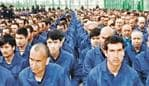 An image of Uyghur prisoners in a Chinese detention camp.