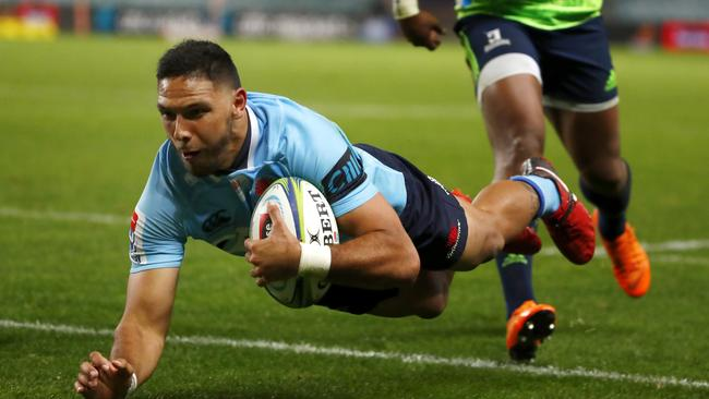 Curtis Rona of the Waratahs scores a try against the Highlanders at Allianz Stadium.