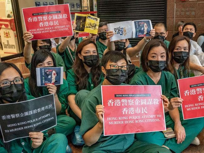 Members of the medical profession gather to protest against Hong Kong police brutality at Queen Elizabeth Hospital.