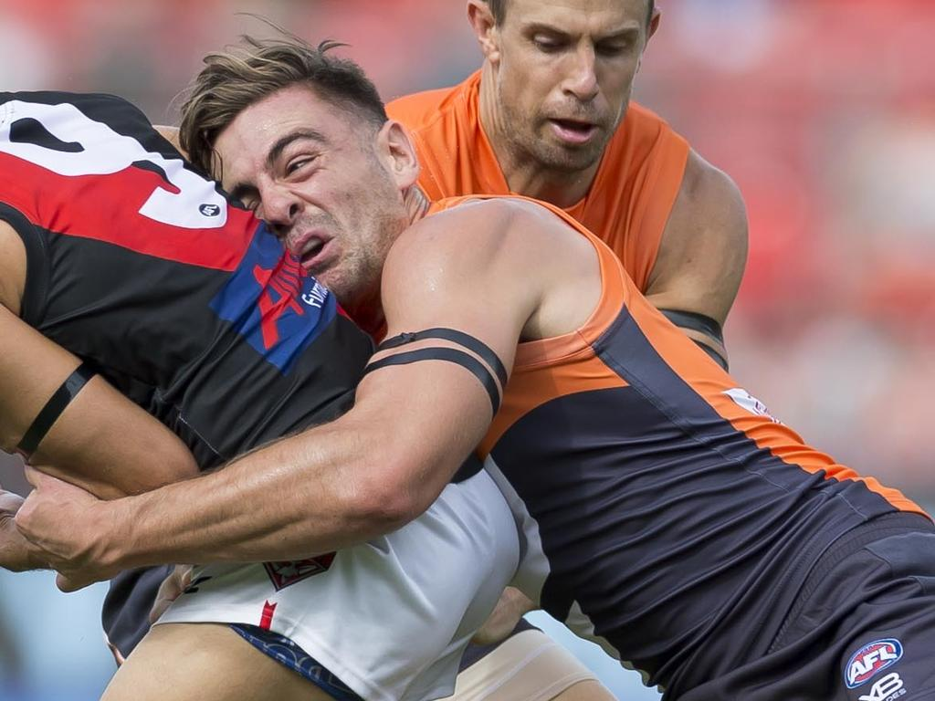 Stephen Coniglio of the Giants tackles Dylan Shiel of the Bombers during the Round 1 AFL match between the GWS Giants and Essendon Bombers at the Sydney Showgrounds Stadium, Sunday, March 24, 2019. (AAP Image/Craig Golding) NO ARCHIVING, EDITORIAL USE ONLY