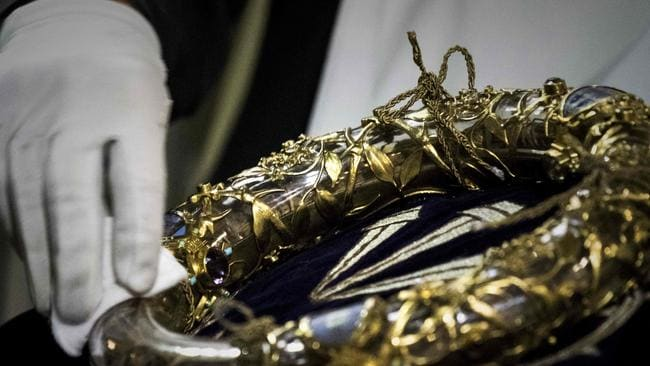 A priest wiping the Crown of Thorns, a relic of the passion of Christ which is housed at Notre-Dame. Picture: AFP