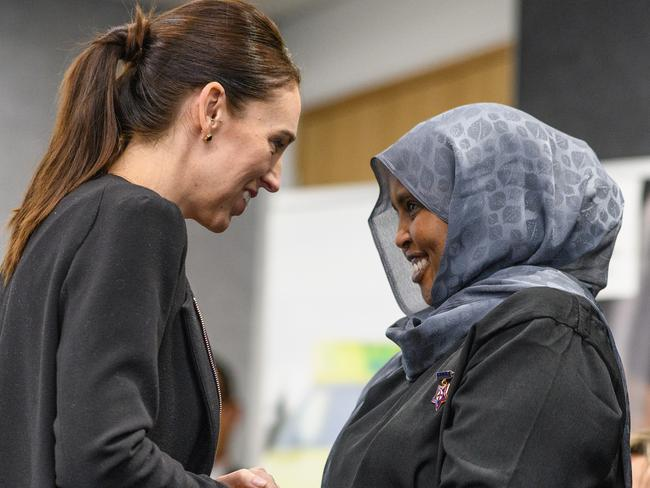 New Zealand Prime Minister Jacinda Ardern greets a first responder of the Christchurch attacks. Picture: Getty Images