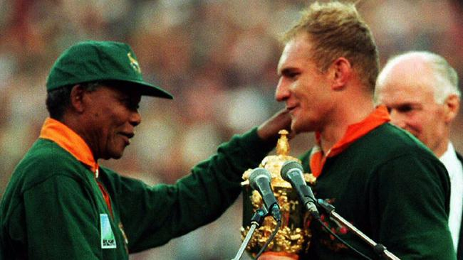 South African President Nelson Mandela hands the William Webb Ellis Cup to Francois Pienaar.