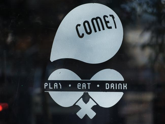 A sign for the Comet Ping Pong restaurant is seen on its door. The Washington pizzeria was falsely reported to house a pedophile ring has elevated worries over the unrelenting rise of fake news and malicious gossip on the internet. Picture: AFP