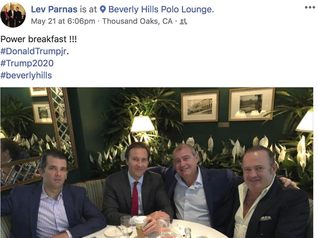 Lev Parnas (second from right) and Igor Fruman (far right) are pictured with Donald Trump Jr in Los Angeles in 2018. Picture: AP