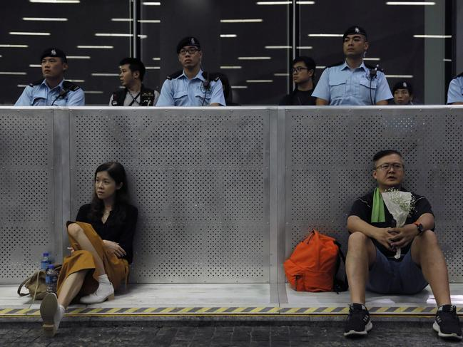 Protesters take rest outside Legislative Council after a march on Sunday. Picture: Vincent Yu/AP