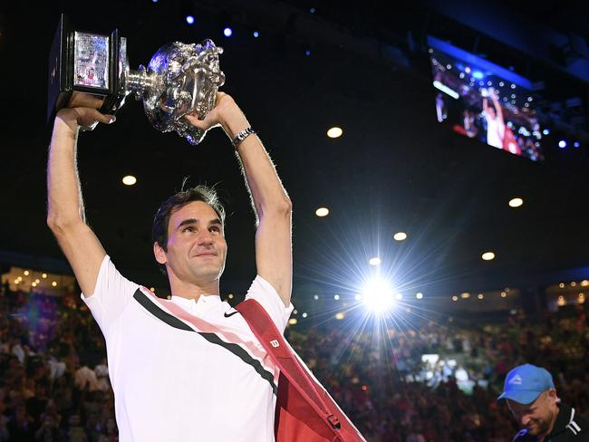 Roger Federer holds the trophy aloft after winning the 2018 final.