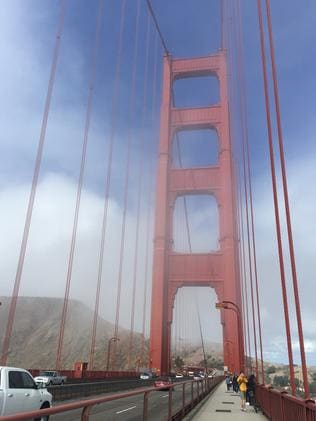 Golden Gate Bridge on a windy, foggy day.