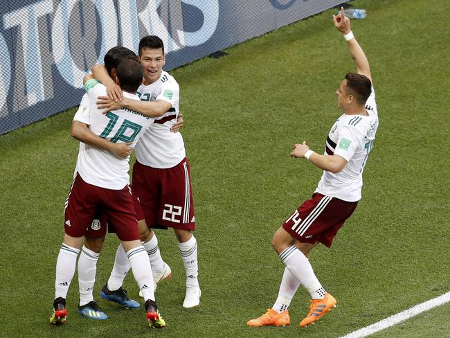 Mexico's Carlos Vela is congratulated (AP Photo/Efrem Lukatsky)