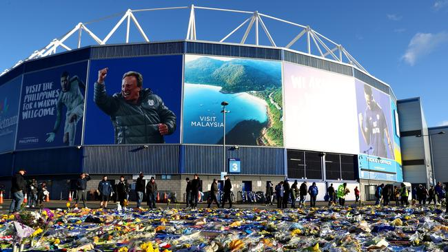 Tributes to Emiliano Sala are seen outside Cardiff's stadium. Picture: Getty