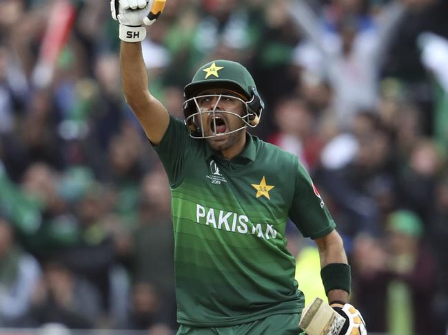 Pakistan's batsman Babar Azam raises his fist celebrate scoring a century during.