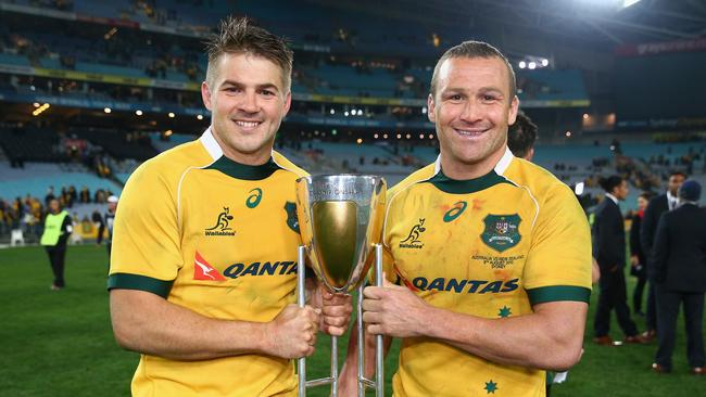 Drew Mitchell and Matt Giteau of the Wallabies pose with the Rugby Championship trophy.