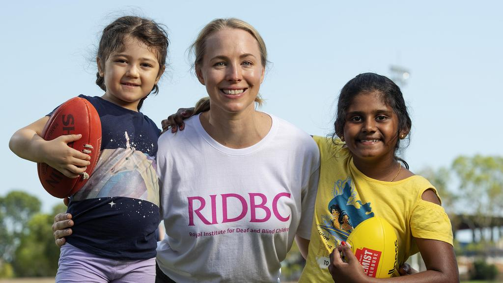 Royal Institute for Deaf and Blind Children teacher Liz Fisher with Iyla Rear, 5, and Irene Suraj, 9, at Marrara Oval for the organisation's first Top End sports camp on Saturday. Picture: KERI MEGELUS