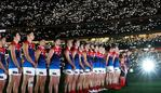 MELBOURNE, AUSTRALIA - APRIL 24: Players pause for the playing of the Last Post during the 2019 AFL round 06 match between the Richmond Tigers and the Melbourne Demons at the Melbourne Cricket Ground on April 24, 2019 in Melbourne, Australia. (Photo by Michael Willson/AFL Photos)