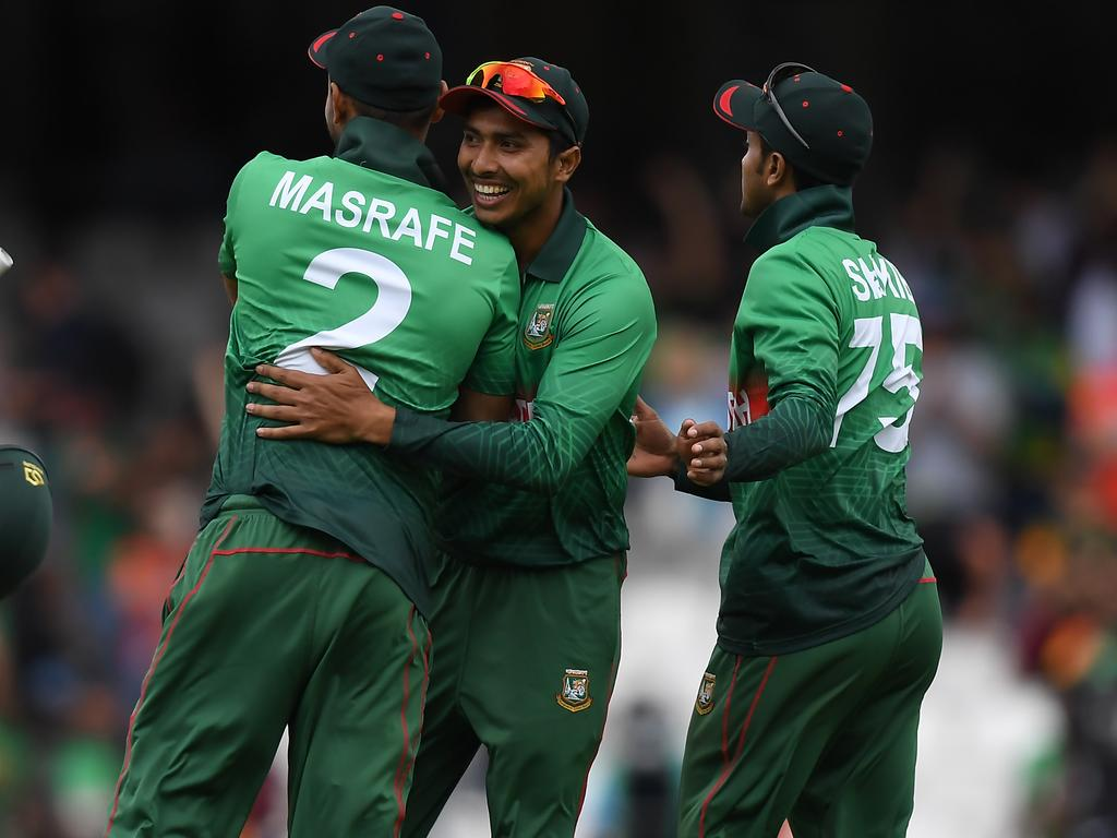 LONDON, ENGLAND - JUNE 02: Soumya Sarkar of Bangladesh (c) and Shakib Al Hasan of Bangladesh (r) and Masrafe Mortaza of Bangladesh (l) celebrate victory during the Group Stage match of the ICC Cricket World Cup 2019 between South Africa and Bangladesh at The Oval on June 02, 2019 in London, England. (Photo by Alex Davidson/Getty Images)