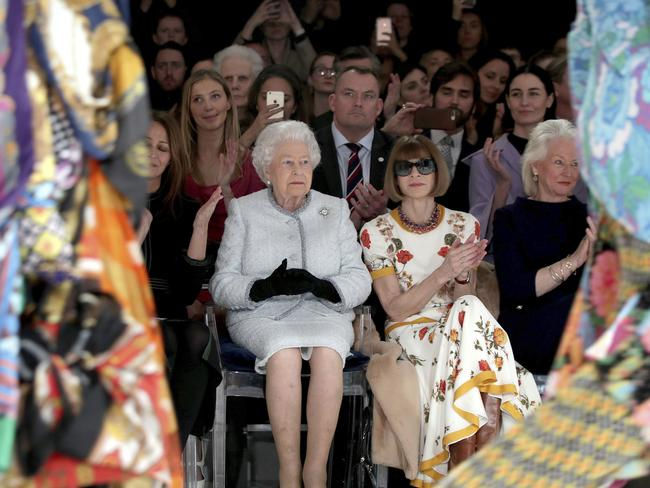 Britain's Queen Elizabeth, second left, sits next to fashion editor Anna Wintour, third left, and Caroline Rush, chief executive of the British Fashion Council (BFC), left, as they view Richard Quinn's runway show. Picture: AP