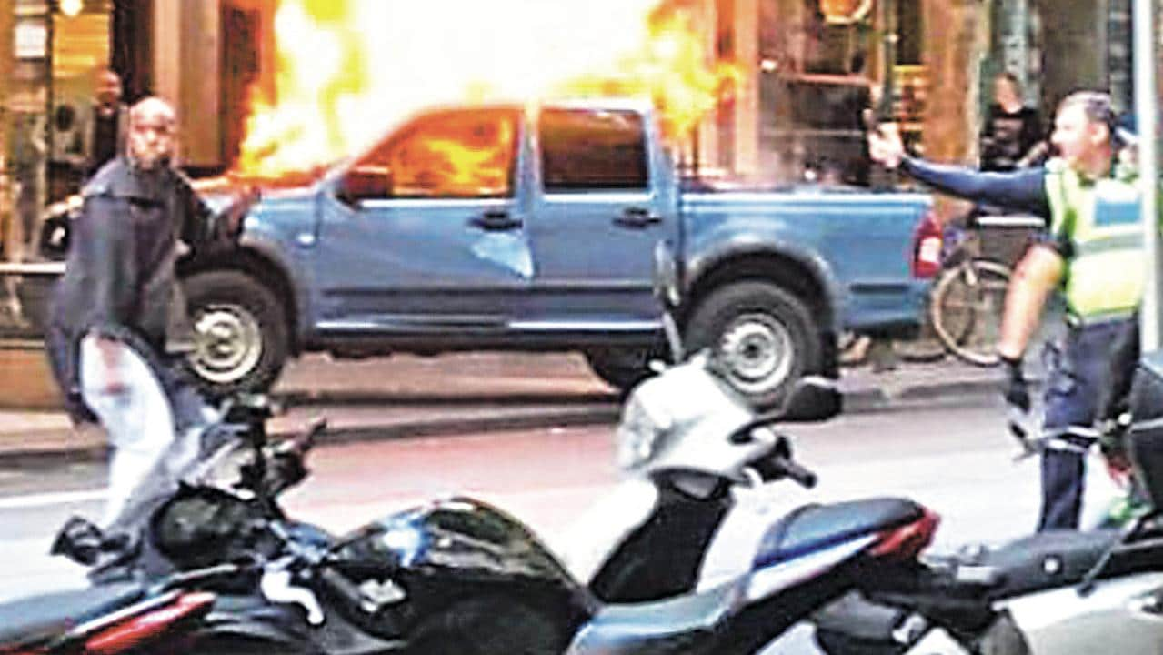 A Policeman Confronts The Killer As His Ute Burns On The Footpath Picture Chris
