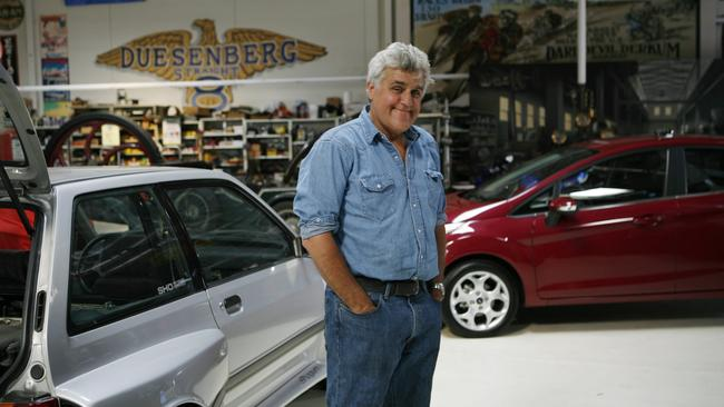 Jay Leno with some of his many vehicles.