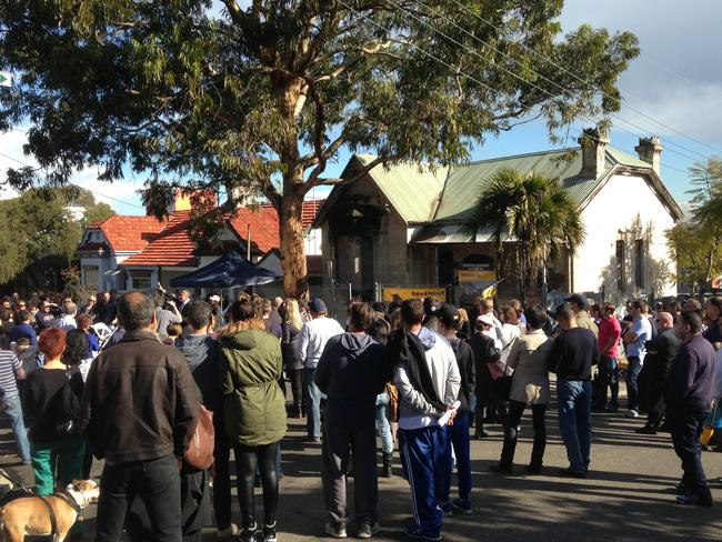 A large crowd came out to watch the auction at 54 Thornley St, Leichhardt.