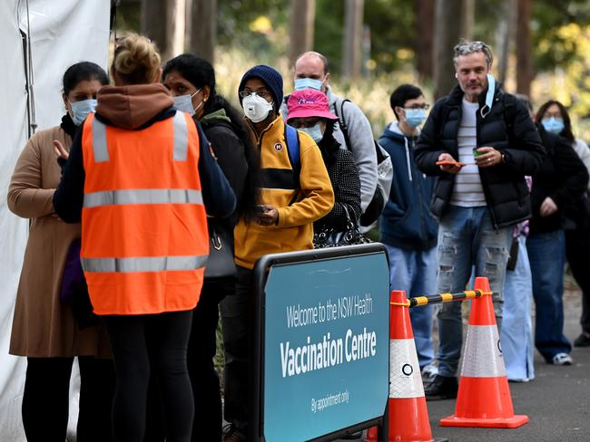 People line up to receive their Covid-19 vaccination at the NSW Health Vaccination hub in Sydney. Picture: NCA NewsWire/Bianca De Marchi